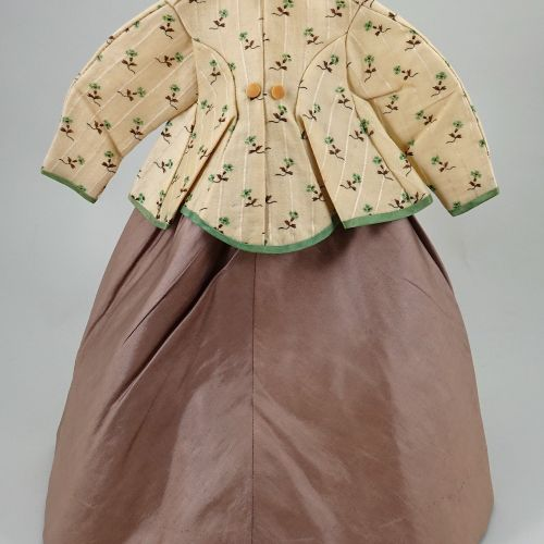 An 1860s 70s style cream and brown silk French fashion dolls dress, An 1860s 70s…