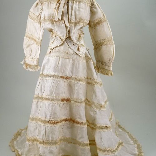 A cream silk dress for large French fashion doll, 1890s, A cream silk dress for …