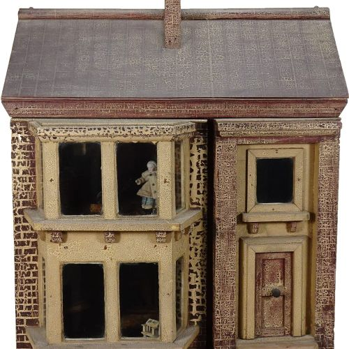 A traditional painted wooden dolls house, made by F.H.Crowe, Newmarket probably …