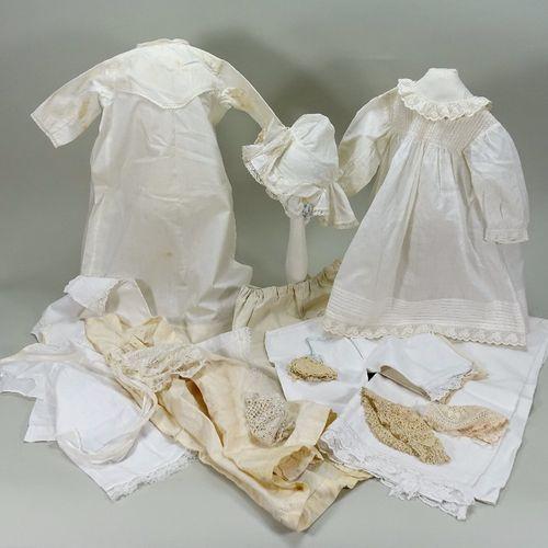 A selection of antique white cotton dolls clothes, A selection of antique white …