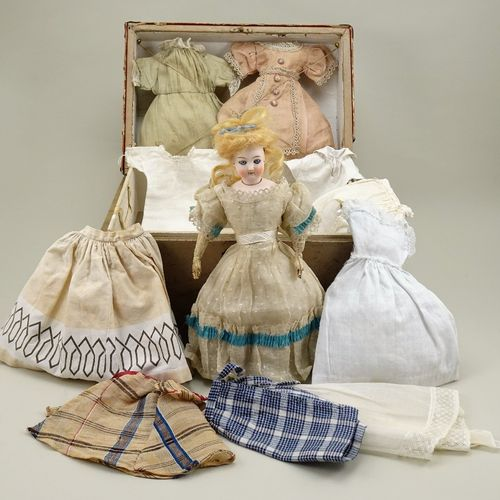 A fine bisque head B.S fashion doll with trunk and clothing, French circa 1870, …