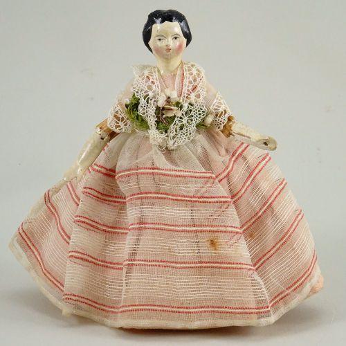 A small papier mache shoulder head doll, German circa 1840, A small papier mache…