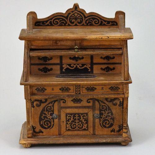 A miniature wooden desk money box, German circa 1910, A miniature wooden desk mo…