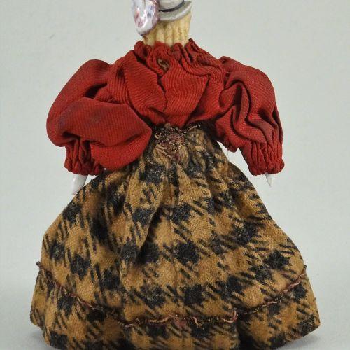 A miniature Parian type shoulder head doll with moulded bonnet, German circa 186…
