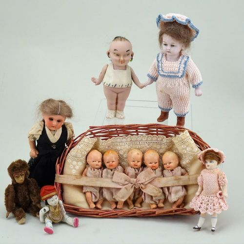 A small collection of miniature dolls and Schuco monkey, German mostly 1920s, A …