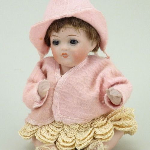 A small all bisque Kestner baby doll, German circa 1915, A small all bisque Kest…