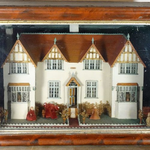 A charming model cottage in glass case, English 1906, A charming model cottage i…