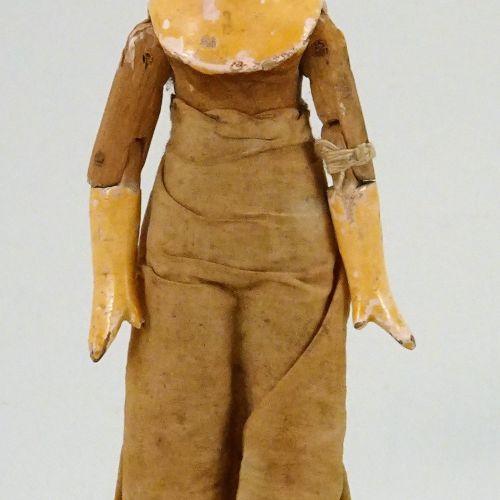 A painted wooden Grodnertal doll, German circa 1820, A painted wooden Grodnertal…