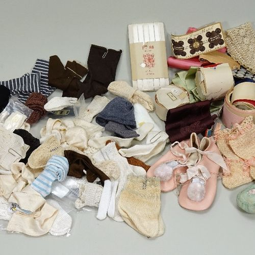 A collection of dolls socks, clothes and bonnets, A collection of dolls socks, c…