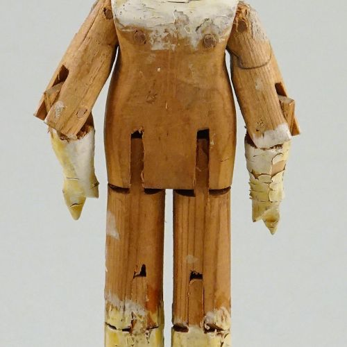 A small painted wooden Grodnertal doll, German circa 1830, A small painted woode…
