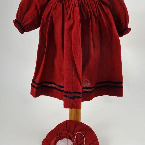A red wool dolls dress and beret, German circa 1890, A red wool dolls dress and …