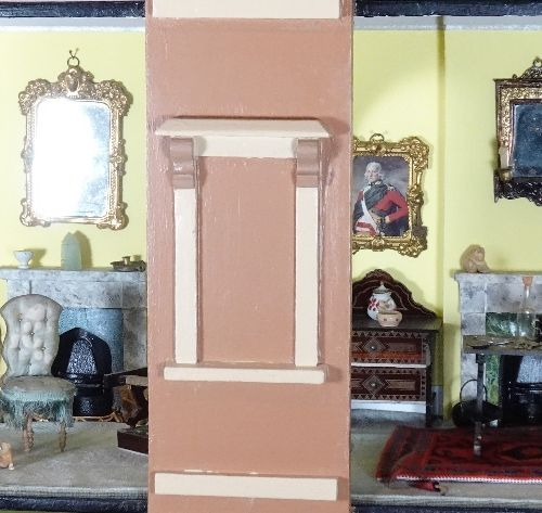 A painted wooden town dolls house, English circa 1890, A painted wooden town dol…