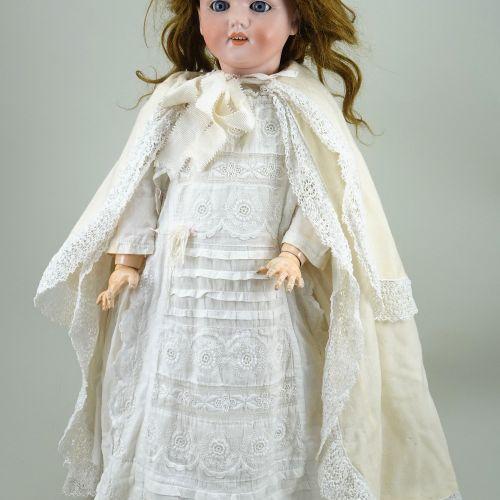 A Schonau & Hoffmeister 5800 bisque head doll, German circa 1910, A Schonau & Ho…