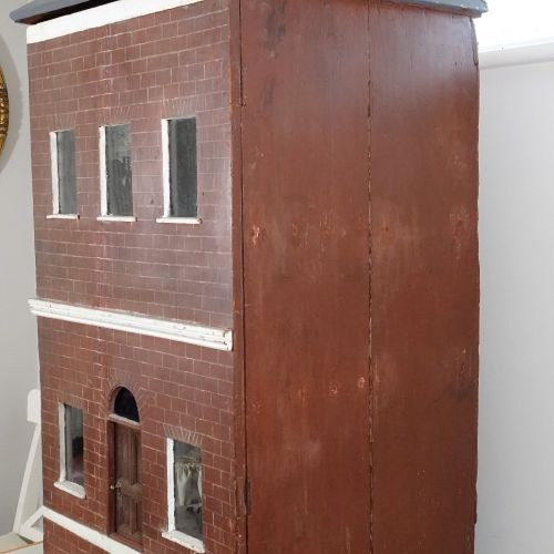 A wooden painted Victorian Dolls House and Milliners Shop, A wooden painted Vict…