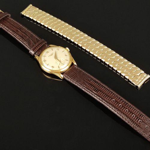 浪琴Calatrava腕表,8878651机芯23Z,750/18K金表壳,表盘上有金色刻度和阿拉伯数字,小秒针,不含表冠直径31毫米,手动上链,50年代,新皮…