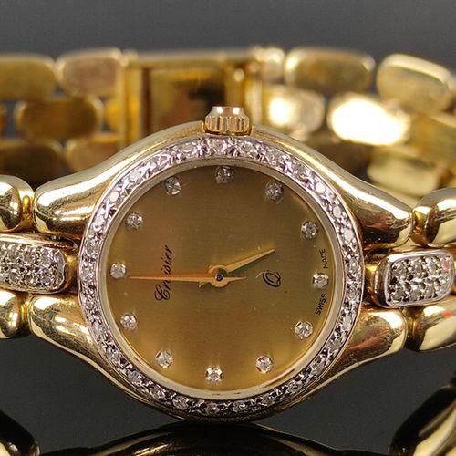 女士腕表,Croisier,石英机芯,表圈镶嵌小钻石,直径23毫米,表带上还有16颗小钻石,585/14K黄金,长18厘米,重36.5克。