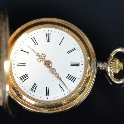 Petite montre de poche, décorée de motifs floraux, émaillée en rouge et bleu, pe…