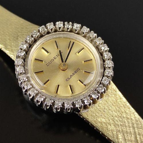 女士腕表,Dugena Classic,腕表印有585/14K黄金,圆形表圈镶嵌30颗小钻石,直径20毫米,重27.3克,长17.8厘米