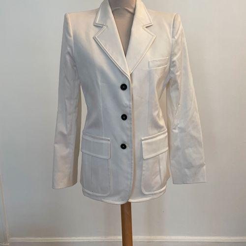 YVES SAINT LAURENT rive gauche  Elégante veste de tailleur en coton blanc.  Quel…