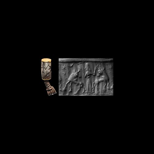 Pendentif en argent et or en forme de cylindre de sceau achéménide. 1er millénai…
