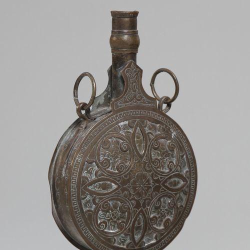 Arte Islamica A brass engraved powder flask North Africa or Turkey, 19th century…