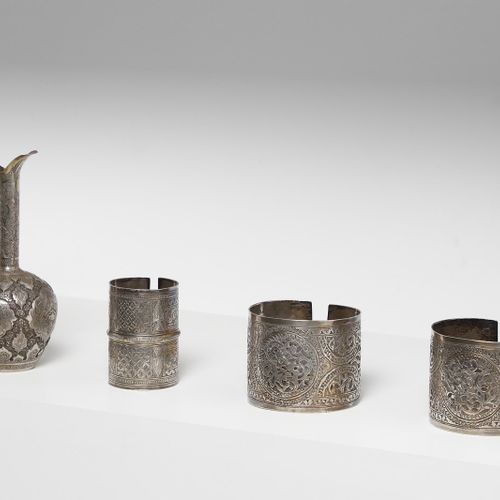 Arte Islamica A group of three silver bangles and a silver jug Persia, 19th 20th…