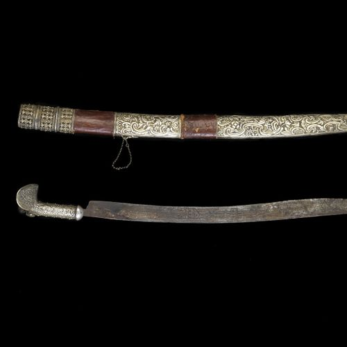 Arte Islamica An Ottoman silver embossed Yataghan sword with decorated blade Cau…