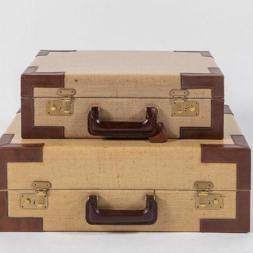 GIOVANNI PATRINI, attr.一对带拐角和把手的皮革和打蜡织物的旅行箱。意大利制造,约1970年。分别为44.5x34.5x14厘米和54.5x…