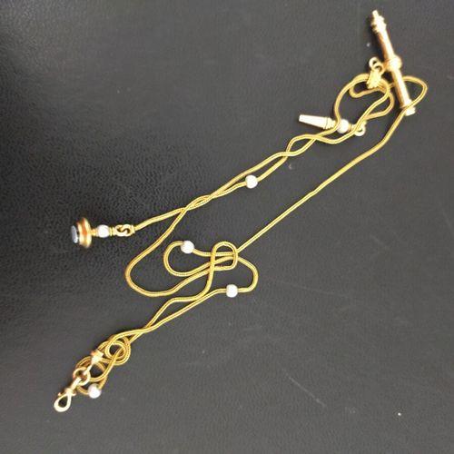 Chaîne giletière à deux brins en or jaune tressé 750 millièmes ornée de petites …