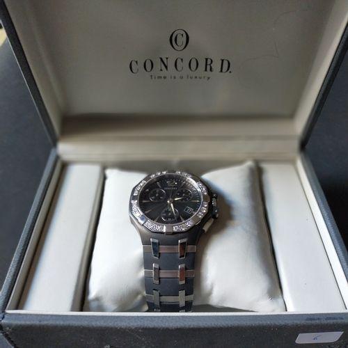 CONCORD  Ref. 14.C5.892 1. No. 1311588.  Chronographe bracelet en acier et résin…