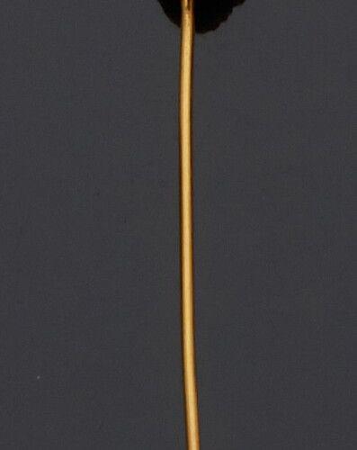 Épingle de cravate en or jaune 18K (750 millièmes) sculptée d'une tête de loup. …