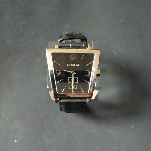 CORUM  Ref. 106.404.20. No. 634254.  Montre bracelet en acier. Boîtier stylisé d…