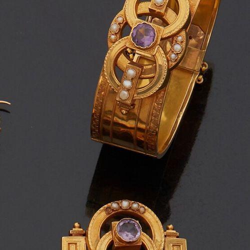 Lot comportant: Large bracelet jonc rigide, ciselé, en or jaune 18K (750 milliè…