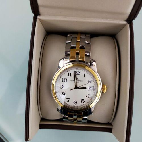 BAUME MERCIER. Montre bracelet d'homme en or 18 K (750) et acier. Capeland MV045…