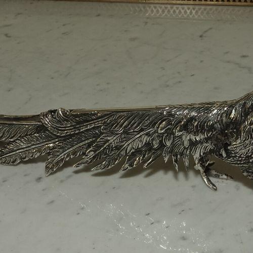Couple de faisans en métal argenté.  Haut. 15 cm Long. 35 cm