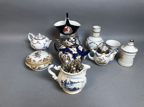Porcelain set: 2 teapots, glass of water, milk jug.
