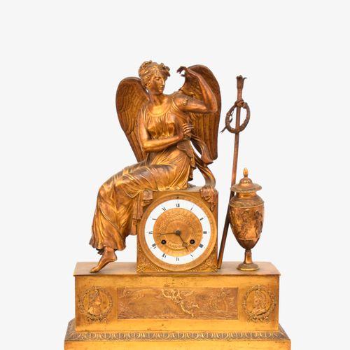 PENDULE « La Renommée »  En bronze doré et ciselé, le cadran émaillé et bronzé  …