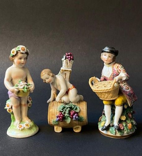 Three miniature subjects in polychrome porcelain  Marks underneath  H: 8 cm for …