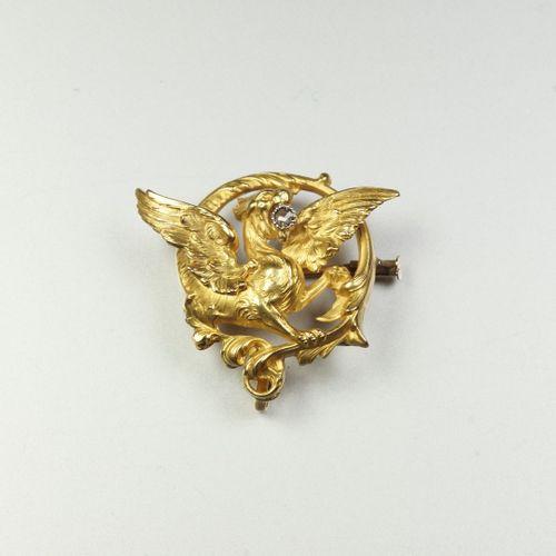 Broche porte montre ancienne en or jaune 18K (750/oo) ajouré figurant une Chimèr…