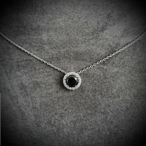 Pendant in white gold centered on a rare round modern cut black dimant weighing …