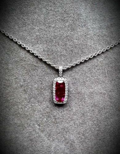 White gold pendant on its chain centered on a Natural baguette cut ruby/ probabl…