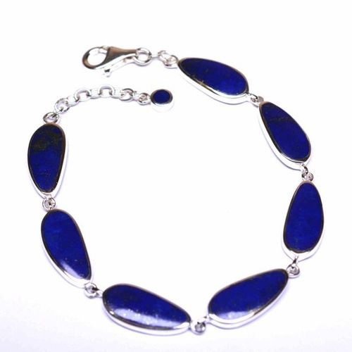 Solid silver bracelet decorated with lapis lazuli with stylized shapes and iride…