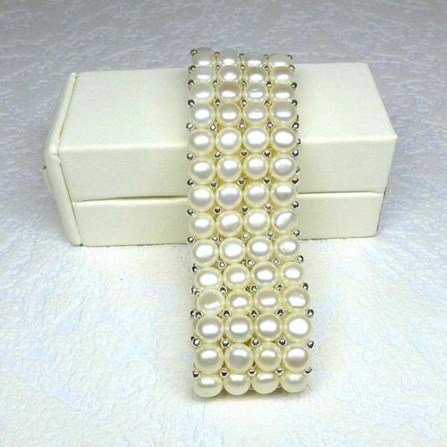 A 4 row bracelet made of 6 mm natural cultured pearls mounted on elastic and dec…