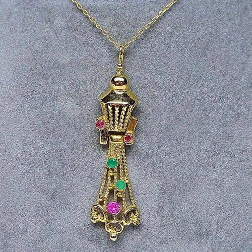 Articulated yellow gold pendant set with green and red stones gold 4,30 g.