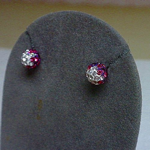 A pair of silver earrings, spherical pattern, pink and white stones.