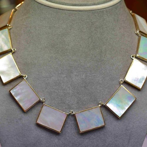 Solid silver necklace set in closed with iridescent mother of pearl patterns of …