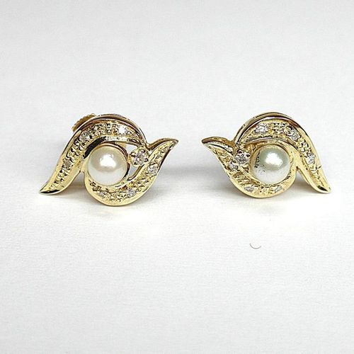 Pair of yellow gold tourbillon earrings set with 2 pearls of very beautiful orie…