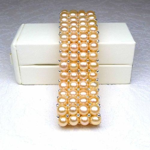 A 4 row bracelet made of 6 mm salmon coloured natural cultured pearls mounted on…