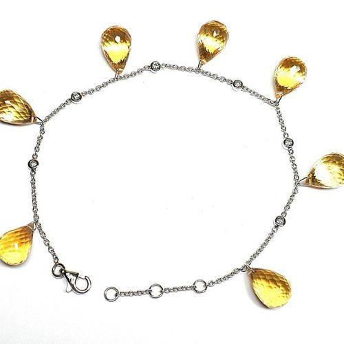 White gold bracelet adorned with 7 citrines briolétées for 35 c. Approx. Interca…