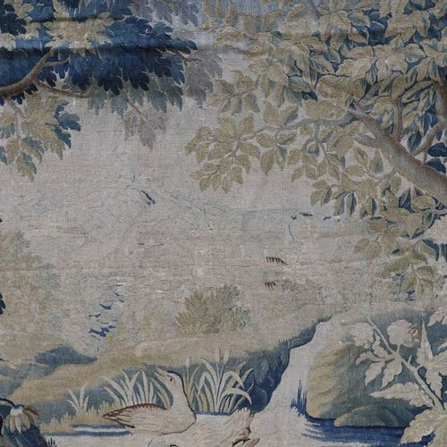 AUBUSSON Tapestry woven in wool and silk with greenery animated by a bird in the…